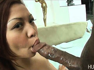 Asian slut slurpin on chocolate cock