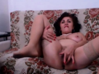 mature with big tits masturbates