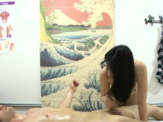 Asian masseuse jerking and fucking her client
