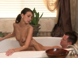 Slender brunette masseuse gives sensual soapy massage