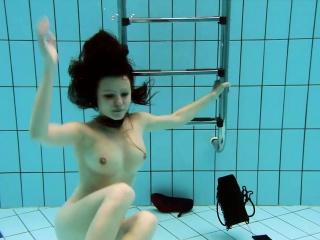 Kristy in a see through dress underwater