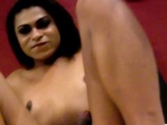 Black lingerie tranny tugging in closeup