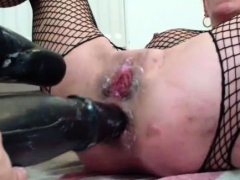 Double dildo fucking her ruined holes