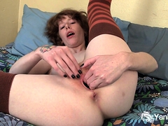 Redhead Staci likes to fill her pussy.  Enjoy as she nearly