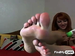 Webcam Russian Ginger-haired Gal, Touches Lotion On Her Soles