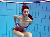 Hot teen Martina swims naked underwater