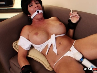 Busty MILF moans while being toyed during bondage