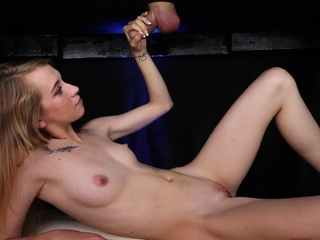 Petite masseuse jerking cock from under table